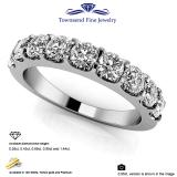 Beautiful design features round diamonds in a shared prong setting.